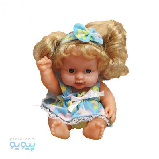 عروسک دختر با لباس گل گلی